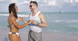 Beautiful diverse couple embracing on beach Footage