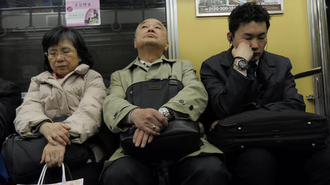 Commuters Travelers People On Japanese Subway Train In Tokyo Japan Live Action