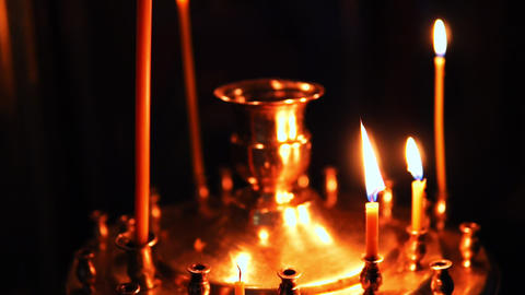 Candle holder with burning candlesticks in the Christian Orthodox Church Footage