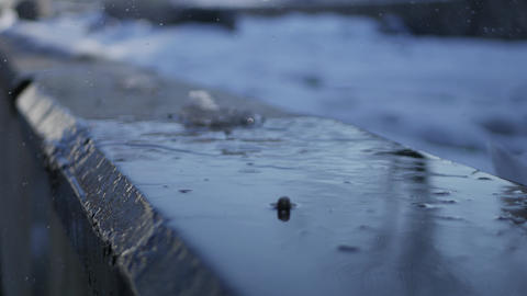 Falling drops from melting snow close up - shallow depth of field cinematic Footage