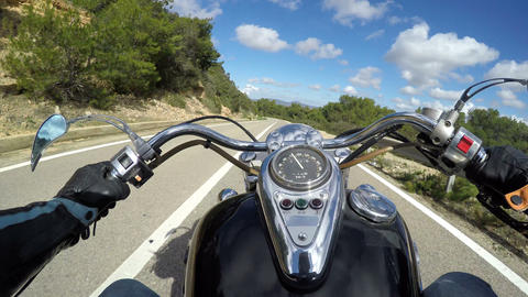 Classic motorcycle riding on a winding road in Capo Caccia, Italy Footage