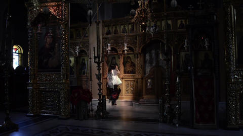 Orthodox believers worships and kiss icons in a church 7 Live Action