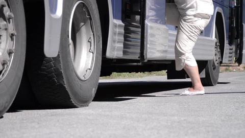 Legs of the passengers who climb the few steps to the entrance of the bus 12 Footage