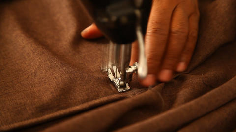 Tailor working at studio Footage