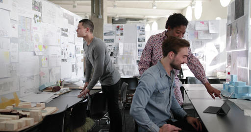 Designers working together in a creative office Footage