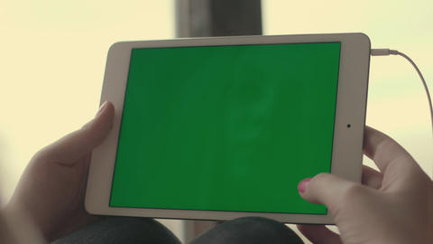 Woman hands using at tablet with green screen and scrolling pages Footage
