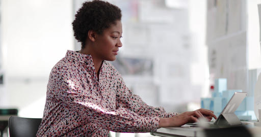 African american female working in creative office Footage