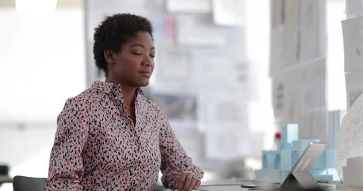 Portrait of African american female working in creative office Footage