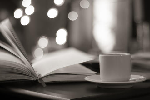 book and coffee with magic bokeh background Fotografía