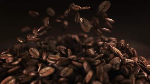 Exploding coffee beans in real super slow motion Stock Video Footage