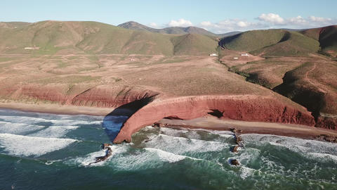 Aerial panorama of Legzira beach with arched rocks Live Action