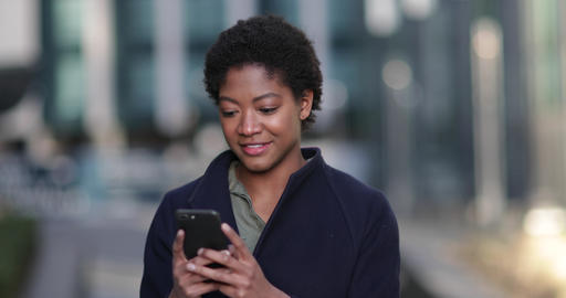 Young adult female using smartphone in city Live Action