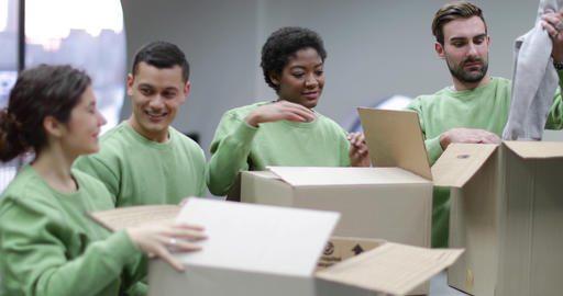 Volunteers sorting clothes donations Footage