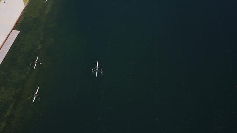 Rowers Training Aerial. People paddle among islands on a lake. Sparkling blue Footage