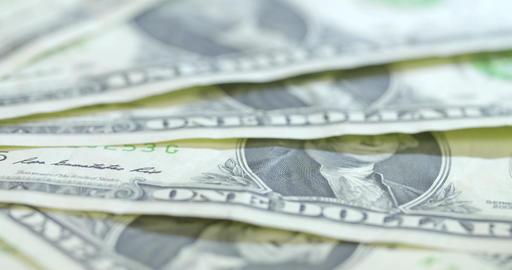 A macro rotating shot of American $1 bills ビデオ