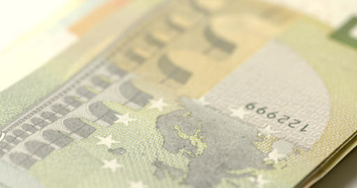 A macro tracking shot across a stack of Euro Notes Footage