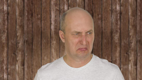 Portrait of bald middle aged man feeling disgust Live Action