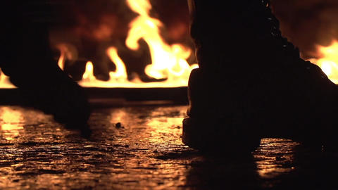 Walking through the fire in a army boots Footage