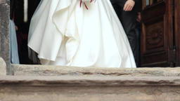 Newlyweds leave the church takes his wife in his hands Image