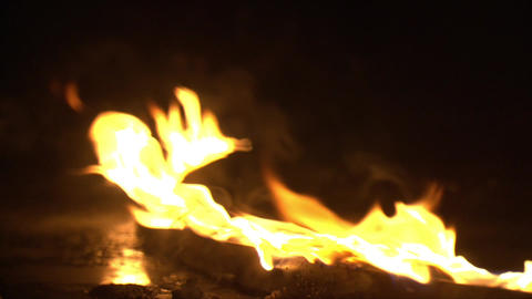 Super Slow Motion Of Clean Flames Igniting And Burning. A line of real flames Live Action