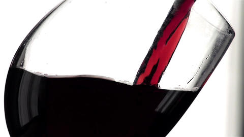 Red Wine Pouring into Glass. White Background. Slow Motion Shot 240 fps Live Action