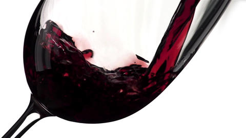 Red Wine Pouring into Glass. White Background. Slow Motion Shot 240 fps Footage