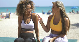 Relaxing sportive women chilling on beach Footage