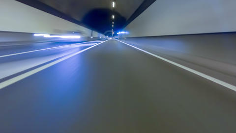 Fast driving by a tunnel.Vehicle shot with preponderance on the asphalt Footage