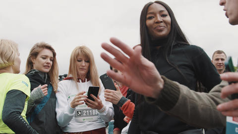 Naomi Campbell at charity marathon smiling and looks confused Footage