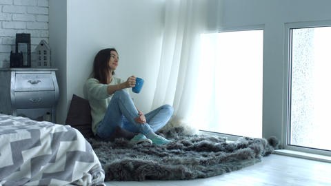 Pretty woman enjoying morning coffee at home Footage