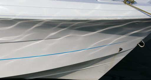 Close up of The Bow of a Boat With Water Reflections Footage