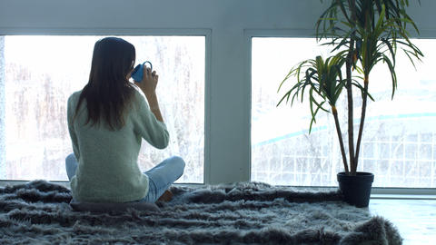 Young woman enjoying cup of coffee in loft apartment Footage
