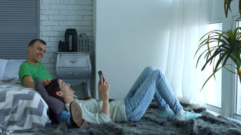 Attractive couple with tablet pc relaxing at home Footage