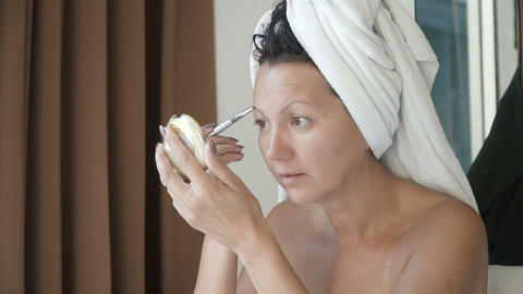 Woman applying skin cream Footage