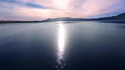 Aerial Shot: vivid purple lake sunset Archivo