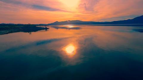 Aerial Shot: vivid purple lake sunset ビデオ