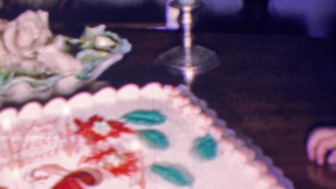 1961: Cute caucasian boy blows kisses waves birthday cake candles Footage