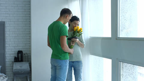 Romantic man giving bunch of flowers to woman Footage