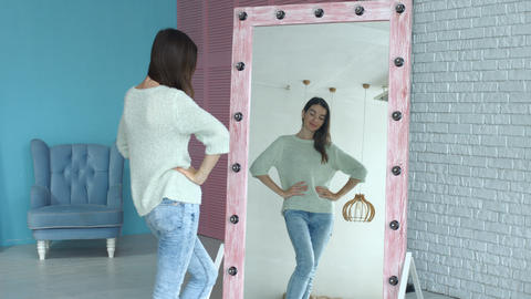 Elegant woman admiring herself reflection in mirror Footage
