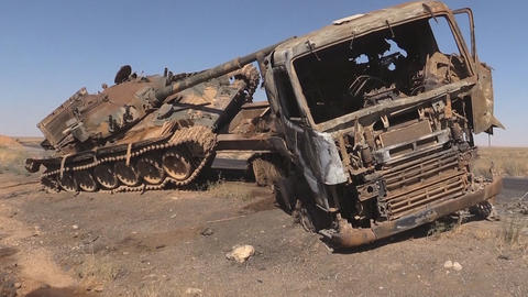 Burnt out technology in Syria on the way to Idlib. (Death Road) Live Action