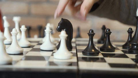 Girl moves bishop on the chessboard Footage