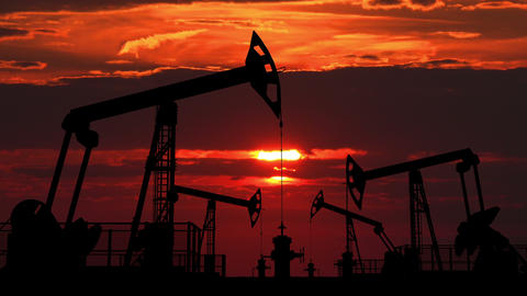 Oil pumpjacks against red dusk Animation