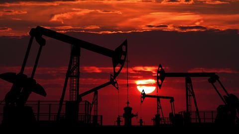 Oil pumpjacks against red dusk Stock Video Footage