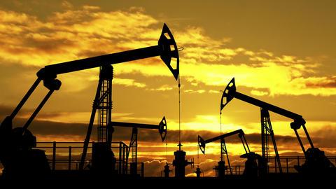 Oil pumpjacks against orange dusk Animation