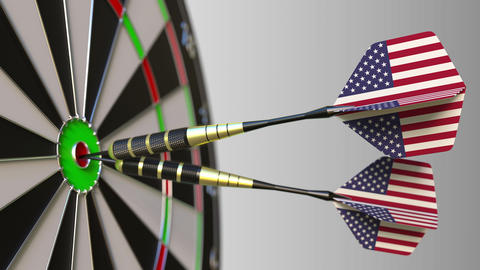 American national achievement. Flags of the United States on darts hitting Footage