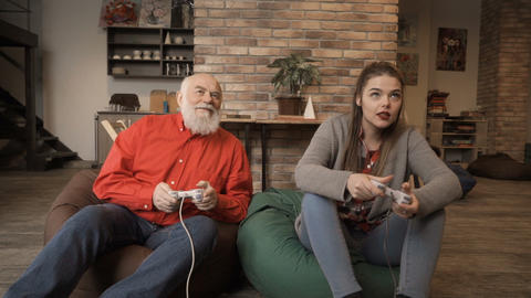 Senior man wins competition in video game in granddaughter Footage