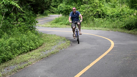 Male Riding Bike on Bicycle Path Live Action