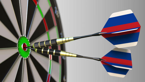 Russian national achievement. Flags of Russia on darts hitting bullseye Footage