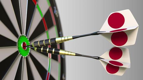 Japanese national achievement. Flags of Japan on darts hitting bullseye Footage