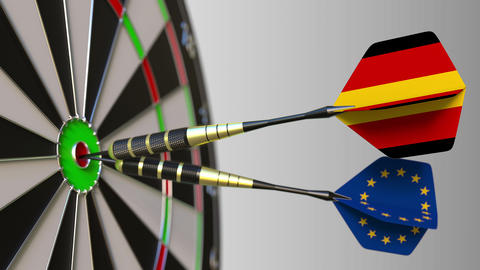 Flags of Germany and the European Union on darts hitting bullseye of the target Footage